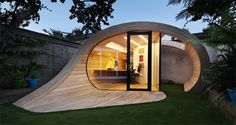 Organic Shaped Backyard Office Doubles as a Storage Shed