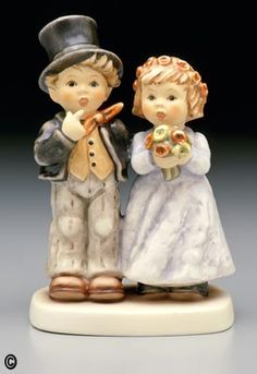wedding cake topper hummels....had to pin it because of my grandma :)