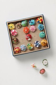 set of 20 mini Pinwheel Push Pins {from Anthro} These might be a DIY project. It'd be fun to choose your own fabric. Love fabric.