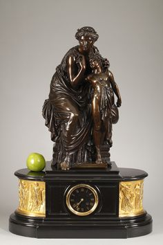A late 19th century bronze group with dark brown patination featuring Venus and Adonis on a black marble mantel clock decorated with a gilt bronze frieze of huntresses. Dial with...