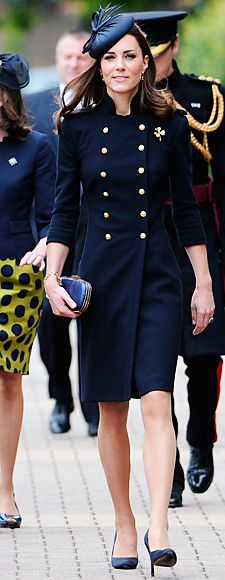 The Duchess of Cambridge visited the Victoria Barracks in Windsor, England to attend a medal parade for the Irish Guards. She went military-chic in a navy double-breasted Alexander McQueen coat, which she accessorized with a feathered fascinator