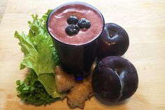 """Ingredients: 2 plums 1 pint (16 oz/400 g) blueberries 1"""" piece of ginger root 1 handful green leaf or romaine (cos) lettuce Directions: 1.) Wash plums, berries and lettuce. 2.) Remove pit from the plum. 3.) Slice ginger 4.) Juice, pour over ice (optional) and enjoy! Substitutions: Blueberries- blackberries"""