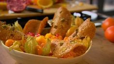Festive fruit salad with brandy snap ---- Feel free to multiply this recipe up for a buffet. Any leftover brandy snaps can be stored in an airtight container and filled with cream, or better, with ice cream.