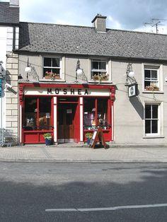 "create interesting ""moldings"" with paint  Irish Pub Shopfronts O Sheas Borris"