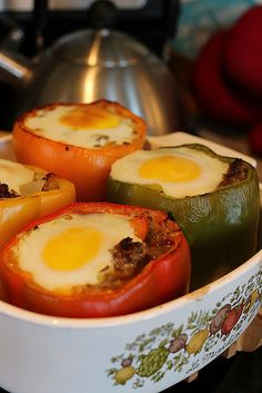 A twist on our favorite high-protein dish — the breakfast-stuffed peppers with eggs and sausage! Source: Mama Loves Food
