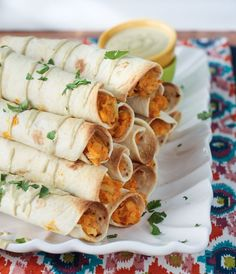 Buffalo Chickpea and Artichoke Taquitos are perfect party food - especially great for game days! Using pantry and fridge staples make these vegan taquitos easy to prepare. You can even make them ahead of time and freeze them. Veggie Recipes, Whole Food Recipes, Vegetarian Recipes, Cooking Recipes, Going Vegetarian, Vegan Snacks, Vegan Dinners, Vegan Appetizers, Tex Mex