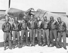 Eight Tuskegee Airmen in front of a P-40 fighter aircraft. By The original uploader was Signaleer at English Wikipedia