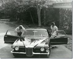Elvis with his 1971 Stutz Blackhawk production model - 144 Monavale Street, Beverly Hills - with each Stutz, there was always a 'plaque' attached to the dashboard that stated who the car was 'Made expressly for'. Despite Elvis' car being closely guarded, each time his car came to be serviced, someone took the plaque!! Employees, fans, anyone who wanted a genuine keepsake helped themselves. http://www.elvis.com.au/presley/stutz.shtml