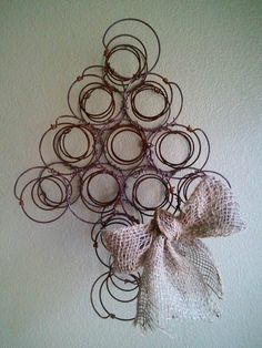 "- Reclaimed Rusty Bed Springs turned Christmas tree. You could place family pictures behind each spring and display it year around! Love it for the ""Old House""!!!"