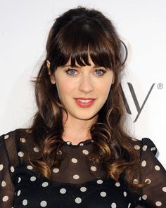 Zooey Deschanel opts for a retro-chic half up-do with teased crown