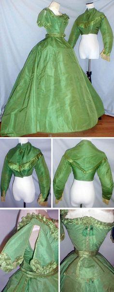Green silk dress with two bodices, 1860s. Evening bodice has pleated green satin ruffles and rosettes and closes in back with green silk lacing trimmed with green silk tassels. Day bodice trimmed with pleated satin and green satin rosette; lined with cotton; front hook and eye closure. It has long pointed front and back; lined with cotton. Skirt has long back sweep and is fully lined with cotton. Ensemble includes separate belt that has center back peplum. Via fiddybee/ebay.