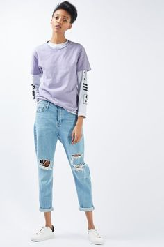 This basic t-shirt with nibbling detail is a fashion essential for casual-cool dressing. We love it with ripped jeans and white trainers for a tomboy chic look. #Topshop