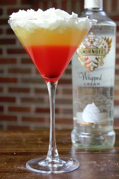 Halloween Candy Corn Cocktail 1 1/2 oz Smirnoff Whipped Cream Vodka 3 oz Sour Mix 2 oz Pineapple Juice 1/2 oz Grenadine Whipped cream for topping