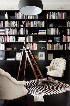 A black backdrop makes books and objets pop like crazy. ,Nixon Tulloch Fortey via Pinterest.
