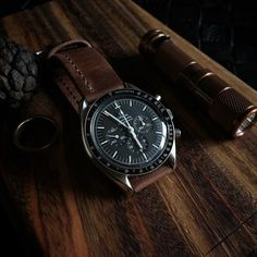 """Omega Speedmaster 3592.50 paired with our Bas and Lokes """"Jack"""" brown handmade leather watch strap and a copper Maratac AA flashlight. Watch strap Available at www.BasAndLokes.com"""