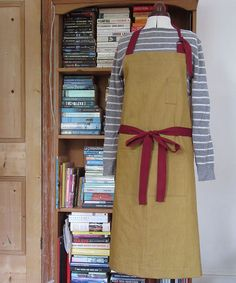Custom order for Much Ado Books. Ochre denim aprons with burgundy colour ties.