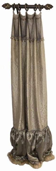 The Versailles Curtain Panels are a combination of Soft Gray and Tan Damask pattern, Metallic Linen, and a Pin-Striped Organza Sheer for a look that is subtle and stately. They detailed trimmings include Beads, Tassel Fringe, and Metal Embellishment that are accented with Swarovski Crystals.