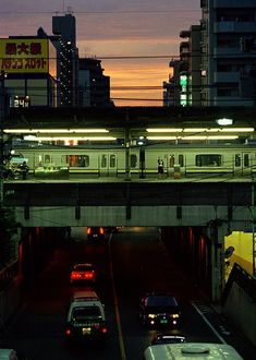 Tokyo - three levels and directions of action - at the top, the sun moving down; in the middle, the train moving through; at the bottom, the cars moving away. Urban Photography, Night Photography, Street Photography, Neon Licht, Neon Noir, City Aesthetic, U Bahn, Robert Doisneau, Night City