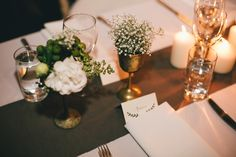 love the baby's breath in the goblets and the clusters of chunky candles | Gabriel & Brady's Elegant Industrial Wedding | The LANE | #tablescape #greenwedding #vintagewedding