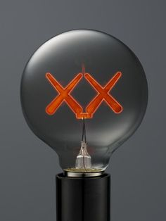 Kaws lightbulbs. Set of 3 color bulbs (red, green, purple) created for The Standard Hotel and available in their online store.