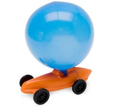 Balloon Racer by Dieter Stein: Blow into the back of the car to inflate the balloon, set down the car and watch it race away. Excellent cause/effect learning toy. $6.50.