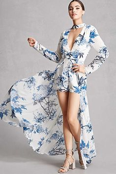 A woven maxi dress by Selfie Leslie™ featuring an allover floral and butterfly print, a V-neckline, padded cups, a center-front O-ring, center-front and side cutouts, long bell sleeves, a tulip high-low hem, and an invisible back zipper. This item runs small, please size up.
