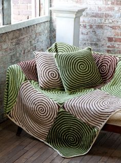 Spiral Crocheted afghan and pillows. Not crazy about the colors they chose, but this could be an interesting blanket in black and white.