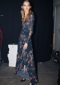 Model backstage at Ganni F/W '15 wearing a floral wrap maxi dress