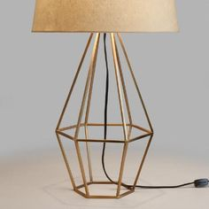 Crafted of cast iron with a warm brass finish and an open, diamond-shaped design, our mid-century-style table lamp adds a unique geometric presence to any room. Top it with any of our table lamp bases to create a personalized look.