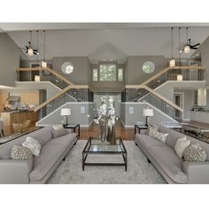 My dream living room! Double staircase with two upper wings of the house!