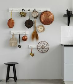 Walls looking a little bare? If you are what you eat, then why not show off your love with a kitchen inspired wall display. This version is all about hanging your mashers, mixers, pans, and pots to make an ornamental testament to the love of cooking.