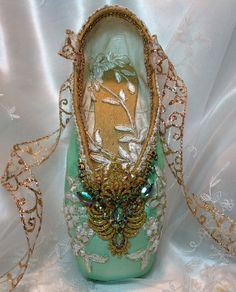 This exquisite pale green and gold decorative pointe shoe definitely evokes the French court where ballet began. This shoe was designed as a