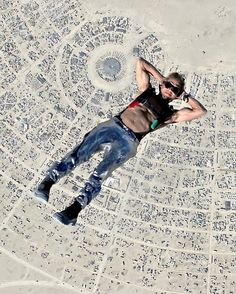 lol skydiving above Burning Man in sparkly disco pants