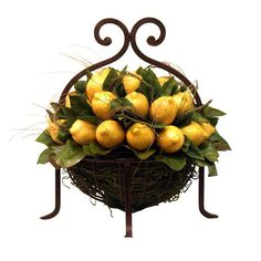 Silk lemon and vine arrangement in a footed basket.     Product: Faux botanical arrangement Construction Material: