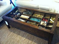 Shadowbox coffee table from Pottery Barn.  Can I add type setter trays to ours to create a similar effect?