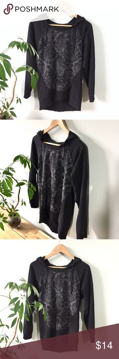 """Black DKNY Hoodie Sweatshirt Perfectly comfortable with such a cool look. Black hoodie with patterned front and wide scoop neck. Back falls longer then front. 100% cotton. 21"""" across bust, 21"""" long down front, 27"""" long down back and 22"""" sleeve length. Best fit S/M. Made in India. Gently worn. Clean, smoke free home. Dkny Tops Sweatshirts & Hoodies"""