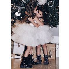 """Flashbacks to the most loving Christmas yet!  Two beautiful girls in Mischka Aoki 'Kiss Kiss my little Rockstar' dress • Regram from @shop_alexis…"""