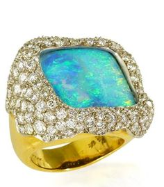 An opal and diamond ring, Andrew Grima the square-shaped opal within a scalloped surround of pavé-set round brilliant-cut diamonds and a tapered gold mount; signed Grima; estimated total diamond weight: 4.00 carats; mounted in eighteen karat gold.