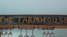 Farmhouse sign on a beam