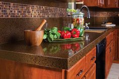 Kitchen, Brown And Wonderful Manufactured Stone Countertop With The Shiny Looking With Some Vegetables And Sink Also The Modern And Unique Backsplash: Furnish Your Kitchen Cabinet With The Manufactured Stone Countertops Recycled Glass Countertops, Outdoor Kitchen Countertops, Cheap Countertops, Refacing Kitchen Cabinets, Laminate Countertops, Concrete Countertops, Kitchen Benchtops, Cement Counter, Cabinet Refacing