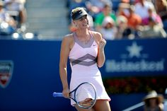 Maria Sharapova (RUS)[3] pumps her fist during her match against Mallory Burdette (USA) in the third round. - Andrew Ong/USTA