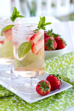 Strawberry Faujito:     6 large strawberries, hulled and cut in half  8 large fresh mint leaves   2 mint sprigs (optional) 2 Tbsp. agave nectar OR simple syrup   3 oz. Bacardi Razz Rum or white rum   8 - 12 oz. sparkling water   ice