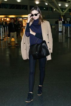 Celebrity Airport Shoe Style: Miranda Kerr wearing Isabel Marant sneakers.