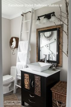 We have a salvaged ladder in our narrow bathroom. We didn't think to attach it at a slant though. That might have been better. Love he towel ladder  Refreshing DIY Bathroom Ideas - Salvaged Farmhouse Bathroom Makeover