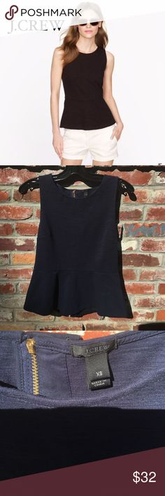 J. Crew Navy Peplum Top PRODUCT DETAILS from J.CREW: All hail the super-flattering peplum top, one of our flirtiest new creations this season. It's the perfect mix of sleek and structured, with a chic back-zip detailing that easily dresses it up or down (meet your new wardrobe workhorse).  Cotton/spandex.  Perfect condition. No stains holes tears or rips J. Crew Tops Tank Tops