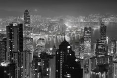 Hong Kong city skyline at night with Victoria Harbor and skyscrapers illuminated by lights o via MuralsYourWay.com