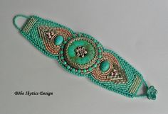 bezsi-beads. Using a donut and silver tube beads