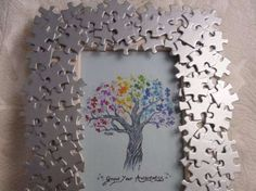 Autism Awareness handmade photo frame with by AutismeAwarenessShop-- easy DIY! Puzzle pieces frame from the dollar tree glue and some spray paint all done :) maybe some sparkles! Puzzle Piece Crafts, Puzzle Art, Frame Crafts, Diy Frame, Puzzle Pieces, Puzzle Frame, Puzzle Picture Frame, Crafts To Make, Crafts For Kids