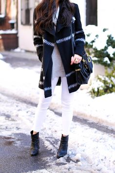 White skinny jeans with black booties