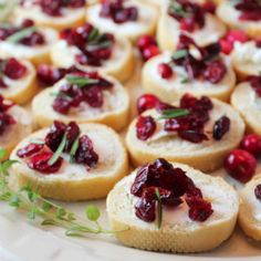 These delicious crostini's are topped with creamy goat cheese, sweet cranberries & fresh rosemary for a light, flavorful appetizer!